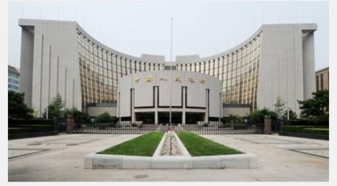 (圖一;中國人民銀行以貨幣寬鬆迎戰貿易戰爭,AFP)