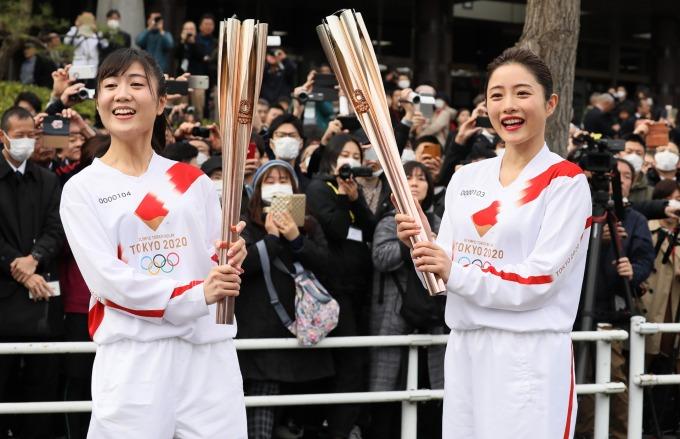 為了怕影響東京奧運,日本政府一開始採取「佛系防疫」。(圖片:AFP)