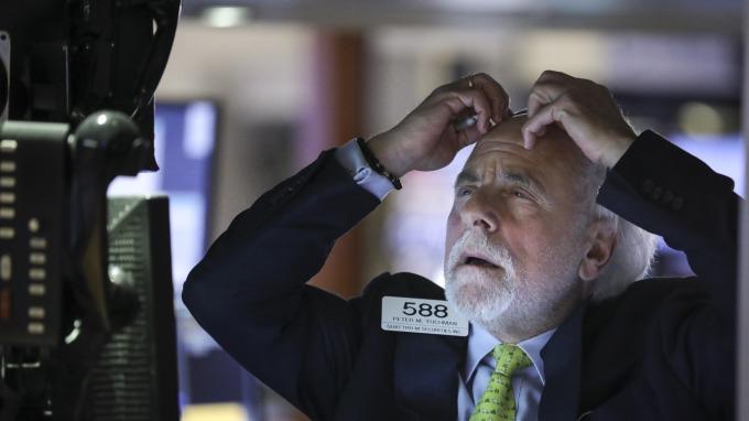 華爾街超狂言論:若人人感染武漢肺炎 可以拯救經濟。(圖片:AFP)