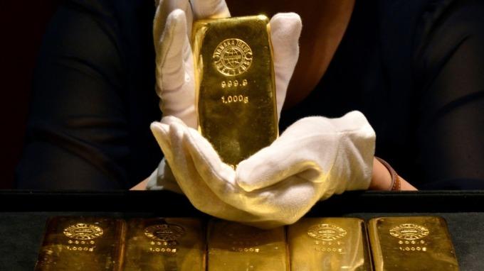 金價突破1700美元,七年來首見。(圖:AFP)