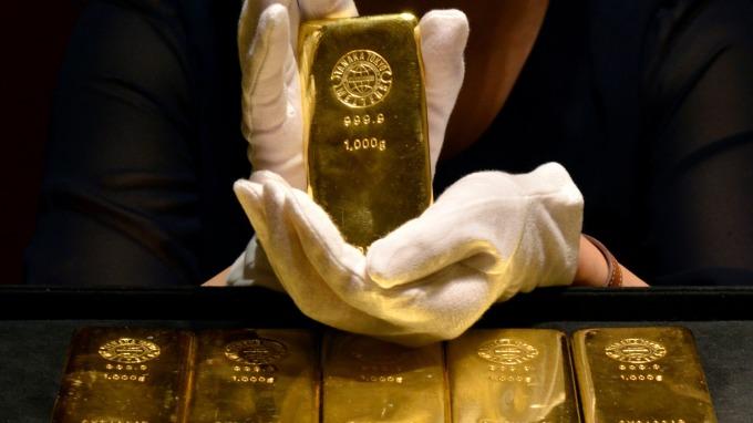搶發疫情「黃金財」?疫情若燒到Q2 金價恐飆到1800美元。(圖:AFP)