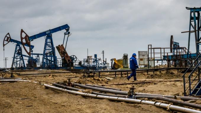 油價跳水,高收債看清楚。(圖:AFP)