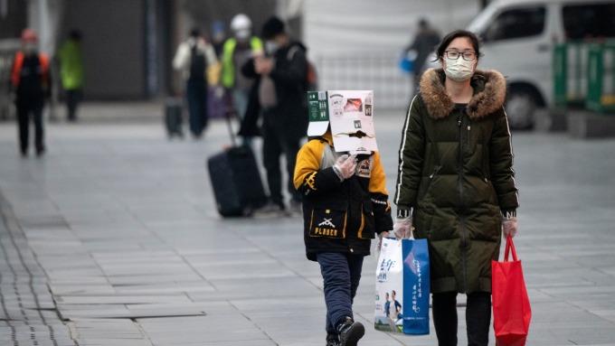 為何新冠疫情起源是中國,陸股卻比較強。(圖:AFP)