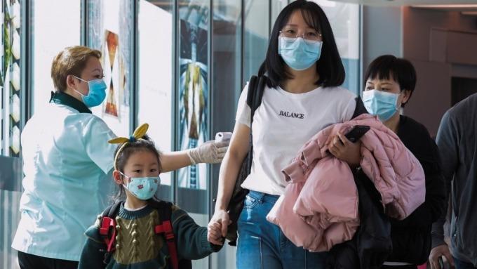 武漢有條件解禁復工 未達條件3/20前不得復工 (圖片:AFP)