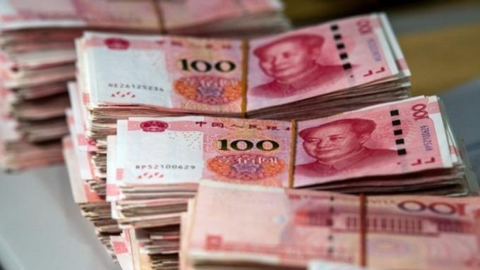 人行宣布降準!釋放長期資金5500億人民幣 (圖片:AFP)