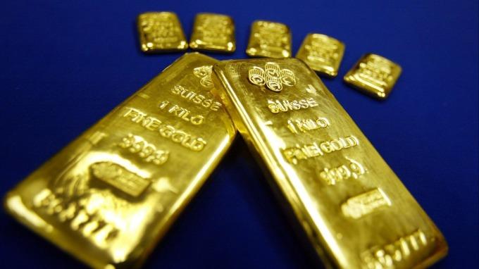 〈貴金屬盤後〉Fed灑錢救急 黃金6日來首次收高(圖片:AFP)