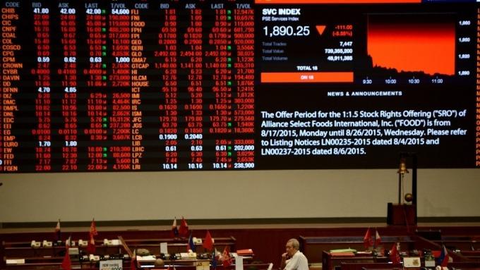 菲律賓股市重新開市後重挫 跌幅一度達24%(圖:AFP)