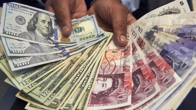 〈紐約匯市〉Fed聯手9央行設換匯機制 美元結束漲福 英鎊脫離35年低點(圖片:AFP)
