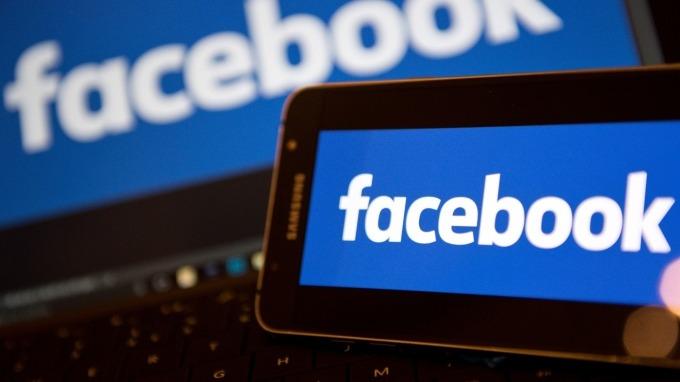 疫情延燒臉書app使用量暴衝  但廣告業務受影響( 圖:AFP)