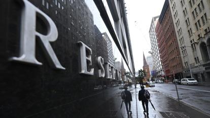 宣布啟動QE後 澳洲央行已買進30億澳幣公債 (圖片:AFP)