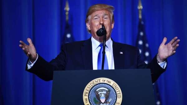 川普警告伊朗:別動美軍 否則將付出沉重代價 (圖片:AFP)
