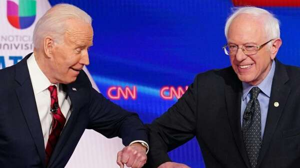 民主黨總統參選人拜登 (左) 和桑德斯 (右)。(圖片:AFP)