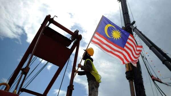 馬來西亞央行:疫情影響 今年經濟成長恐萎縮  圖片:AFP)