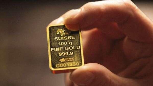 聯準會祭無上限QE 將推動黃金價格攀升(圖:AFP)