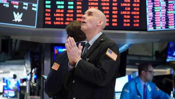 美股每日近5%的上下震盪 你的小心臟承受得住嗎?(圖:AFP)