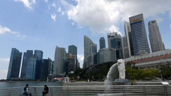 新加坡封城抗疫 美光、應材等晶片商憂生產中斷 (圖片:AFP)