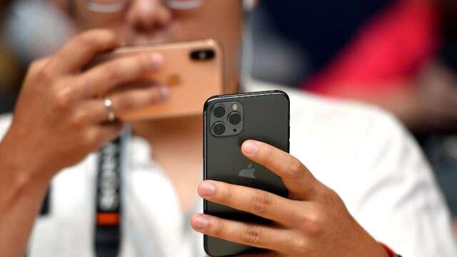 分析師:3月蘋果iPhone中國銷量激增5G手機競爭加劇(圖片:AFP)
