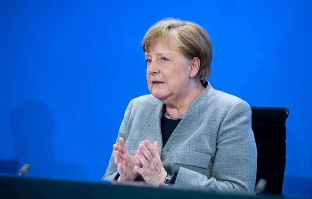 週三德國總理梅克爾 (Angela Merkel) 宣布逐步解封計畫 (圖片:AFP)
