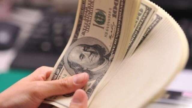 美國貨幣與財政政策全力做多,有利美國高收債後市表現。(圖:AFP)