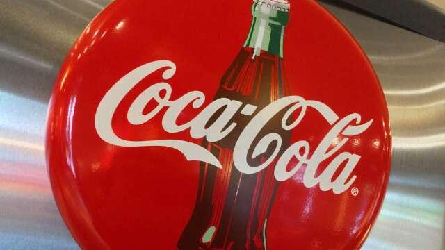 可口可樂業績超預期 受疫情影響取消全年財測  (圖片:AFP)