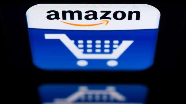 亞馬遜股價不斷刷新高 為何這家機構要調降評級至賣出?(圖片:AFP)