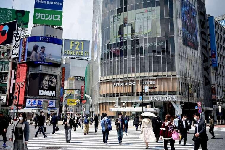 日本 39 縣最快 14 日解除緊急狀態 東京、大阪等還要再等等 (圖片:AFP)