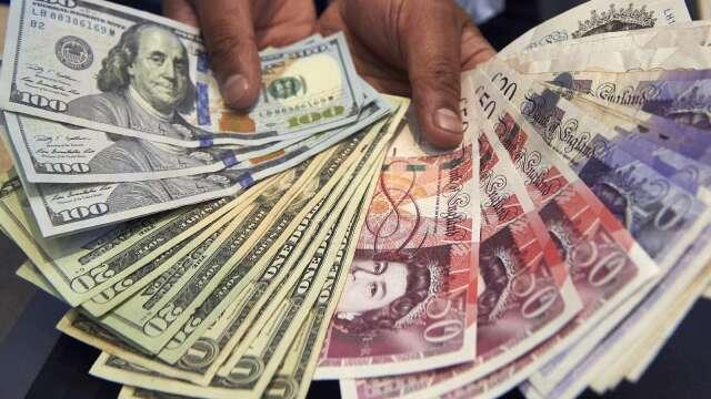 〈紐約匯市〉Fed鮑爾稱經濟前景悲觀 美元避險需求增 英鎊走跌(圖片:AFP)