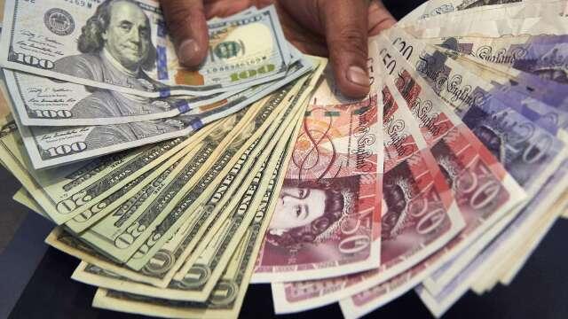 〈紐約匯市〉避險情緒攀升 鮑爾負利率前瞻萎靡美元升至3週來高位(圖片:AFP)