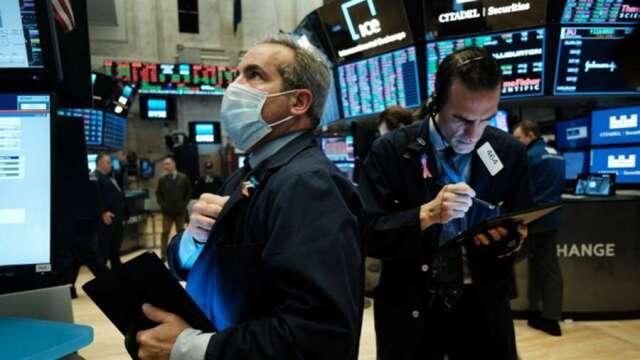全球零利率支撐股市不墜 疫後政經情勢風險有增無減。(圖:AFP)