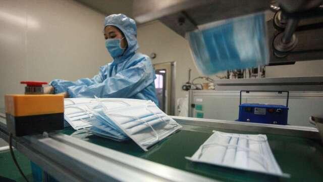 口罩國家隊抗疫有成 快篩、疫苗可望再進軍國際。(圖:AFP)