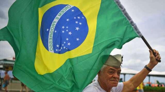 全球新冠確診突破500萬 巴西病例暴衝恐成全球第二高。(圖:AFP)