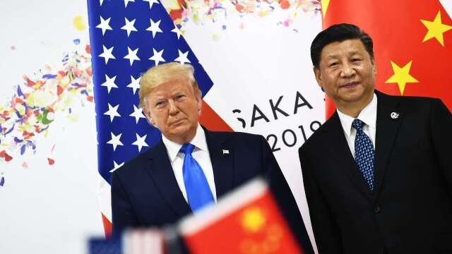 中美貿易戰2.0點火,手中持股停看聽。(圖:AFP)