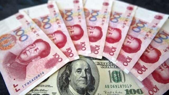 提前放貶因應美國制裁? 離岸人民幣貶至九個月新低。(圖:AFP)