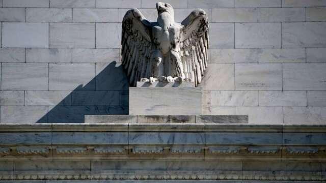 Fed資產負債表擴增至7.1兆美元  購買市政債計畫即將啟動。(圖:AFP)