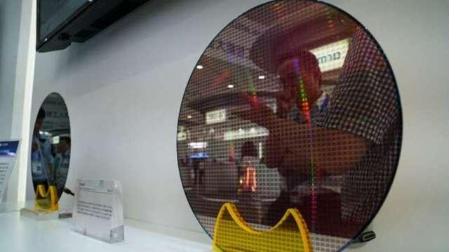 中芯挖角格羅方德高階主管 推銷14奈米   (圖片:AFP)