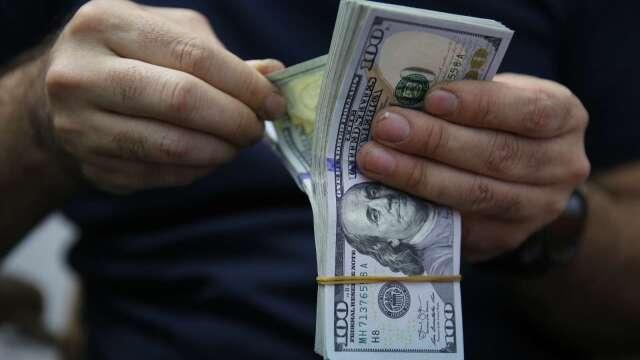 美中關係惡化!路透:美元失色 但資金可能再度湧向避險貨幣(圖片:AFP)