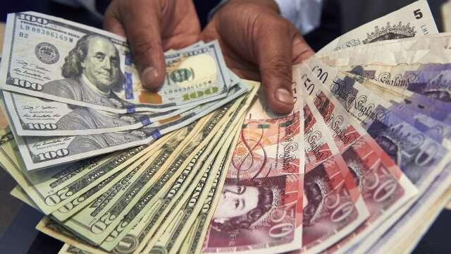 〈紐約匯市〉市場靜待Fed利率會議 美元再墜 日圓登一週來高點(圖片:AFP)