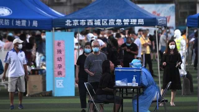 北京疫情再起!WHO呼籲密切調查感染源頭(圖片:AFP)