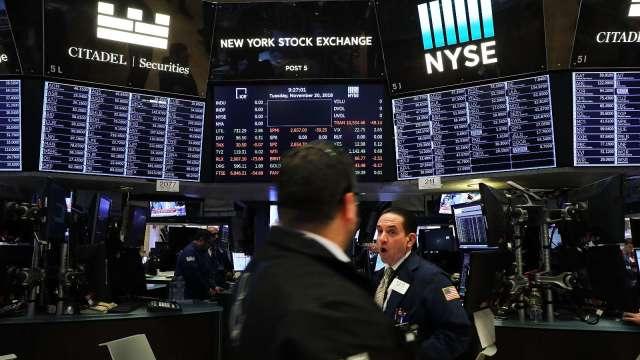 Fed提新刺激政策 華爾街高喊美股多頭延續 (圖片:AFP)