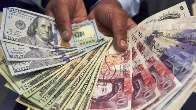 〈紐約匯市〉市場情緒樂觀 美元自三週來高點回落澳幣走強(圖片:AFP)