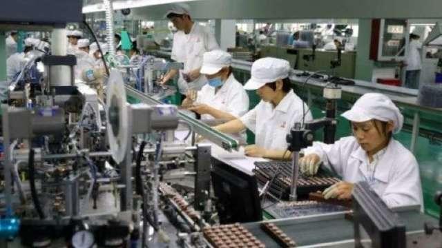 凱投宏觀:防疫有佳+電子產品需求強 台灣經濟相對強勁    (圖:AFP)