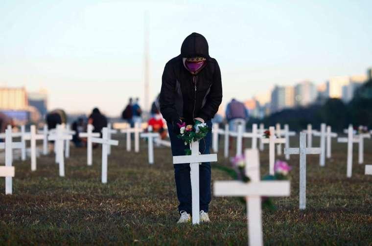 全球死亡數已突破 50.2 萬例 (圖片:AFP)