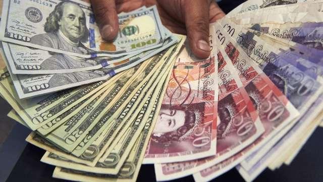 〈紐約匯市〉製造業數據提振 美元流失避險地位 英鎊走強(圖片:AFP)
