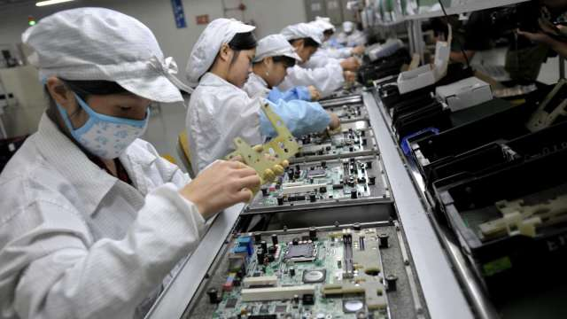 人傳人風險加速企業數位轉型步調,也成後疫情時代下工業電腦廠的新契機。(示意圖:AFP)