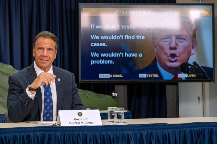 古莫表示,川普可以透過簡單地承認問題並在公共場合戴口罩來遏制疫情 (圖片:AFP)