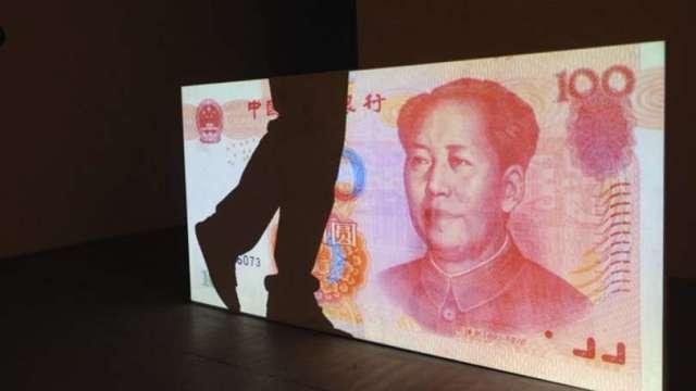 風險暫退 美元走貶 人民幣中間價升逾350基點(圖片:AFP)