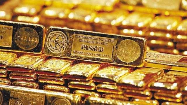 金價漲不停!黃金ETF成投資人「首選武器」上半年吸金400億美元 (圖:AFP)