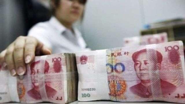 人民幣取代美元避險地位?花旗:可能性很低  (圖:AFP)