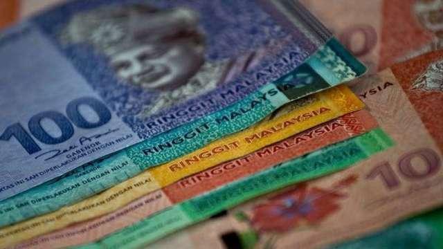 馬來西亞令吉麻煩事纏身 離止穩還早得很。(圖:AFP)
