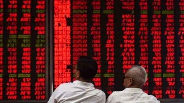 分析師警示槓桿與融資比例上升 陸股飛漲已成雙面刃(圖:AFP)